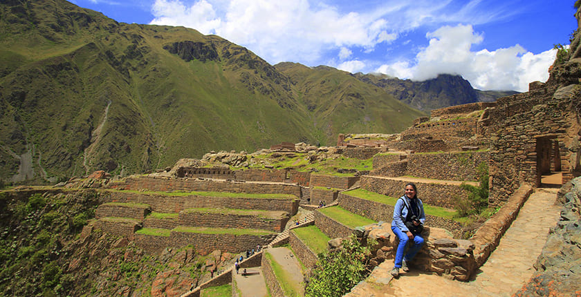 Tourist enjoys ollantaytambo in the sacred valley of the incas